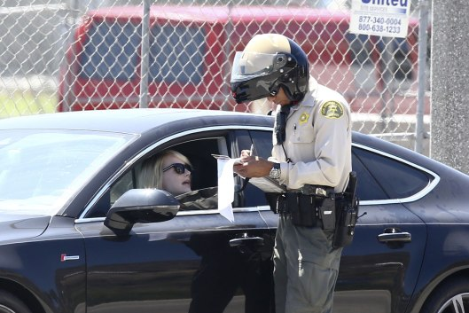 EMMA STONE Tries To Get Out of a Ticket