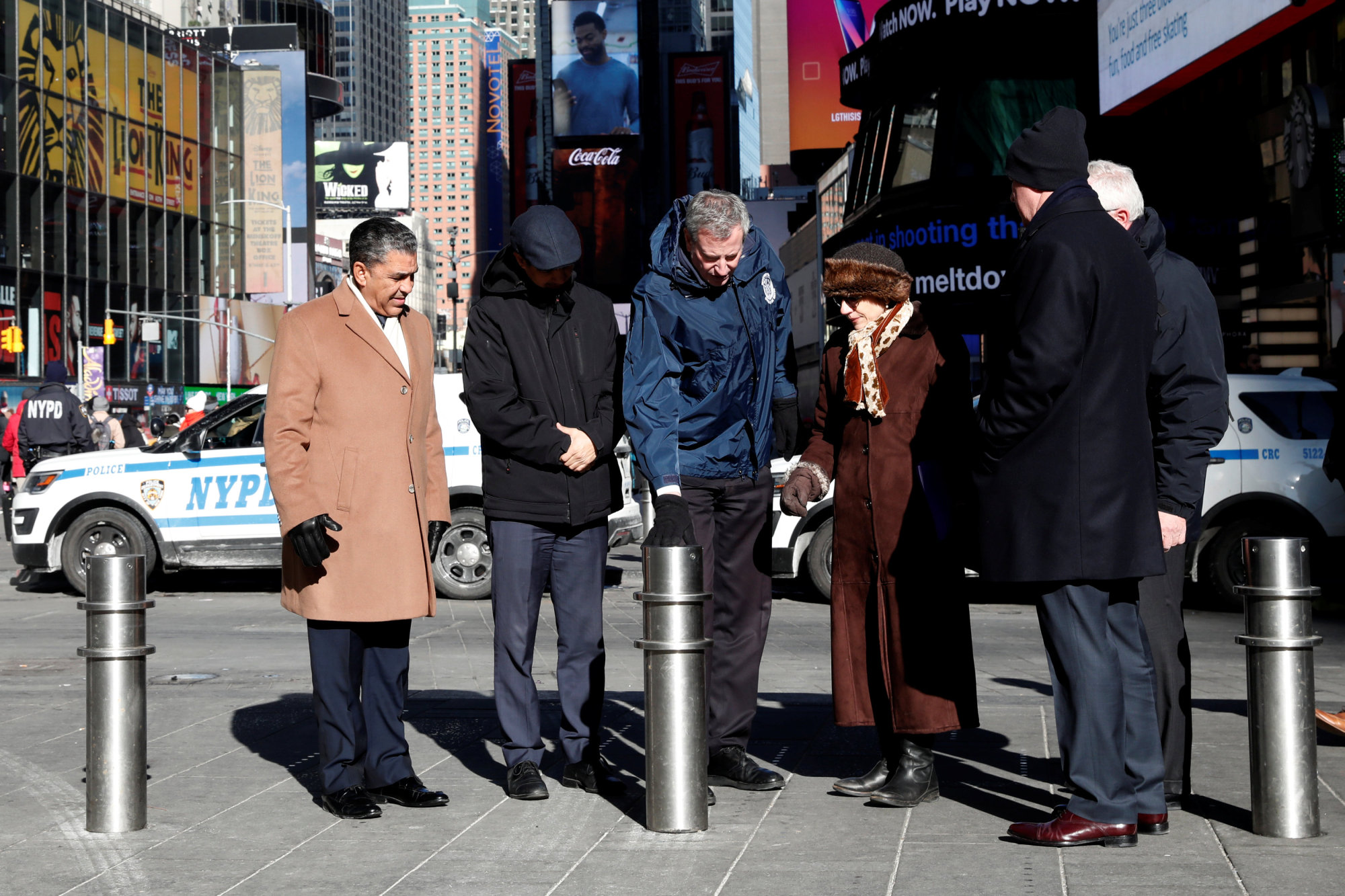 New York City mayor Bill de Blasio, New York City Department of Transportation Commissioner Polly Trottenberg, NYPD Commissioner James O'Neill and U.S. Congressman Adriano Espaillat (D-NY) stand near additional bollards in Times Square, New York City