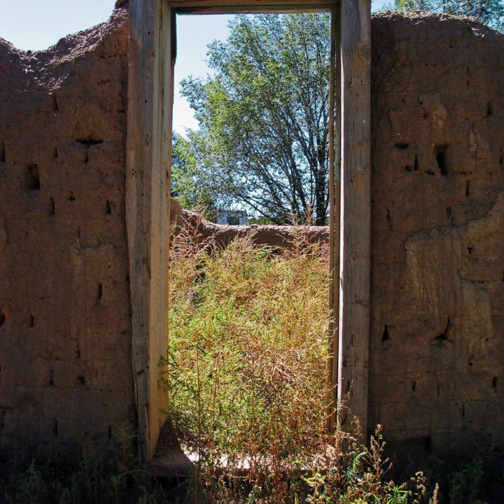 Unfinished adobe construction doorway new mexico