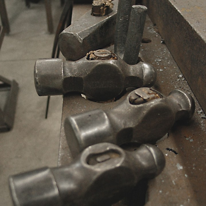 Ball peen and metalworking hammers in a steel work top