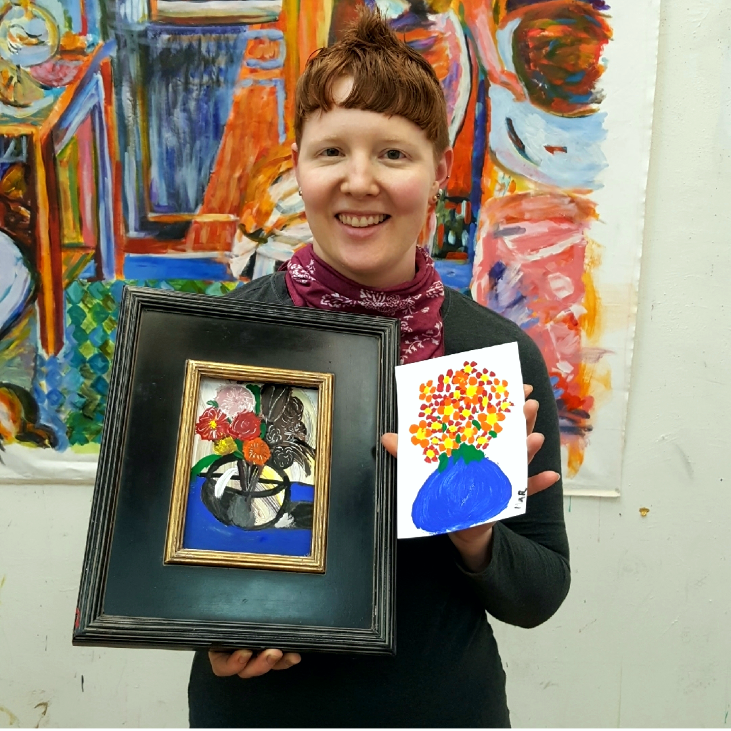 What a difference! A participant holding up her before and after paintings.