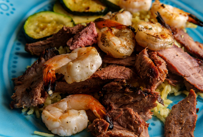 This American surf and turf dinner features char-grilled shrimp