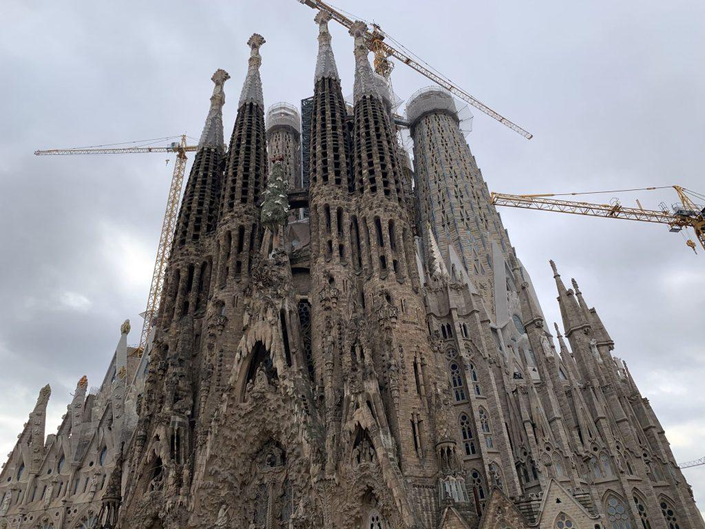 Spires of La Sagrada Familia surrounded by construction cranes