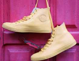 hanging yellow converse high top sneakers