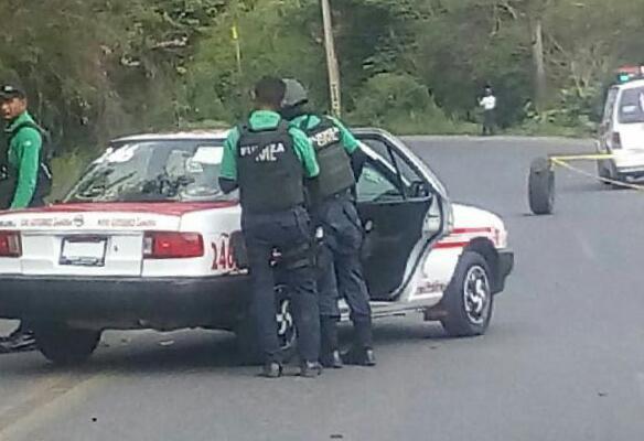 El taxi donde la mujer fue ejecutada
