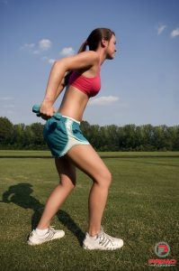 15315-a-healthy-young-woman-warming-up-for-exercise-outdoors-pv