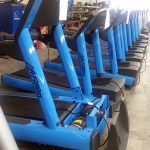 Life Fitness treadmills in an electric blue color shipping to U.S.A.