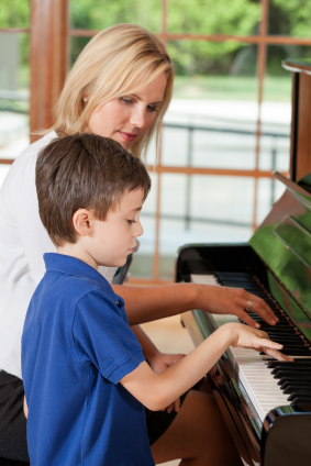 practicing ready for a lesson at the piano school
