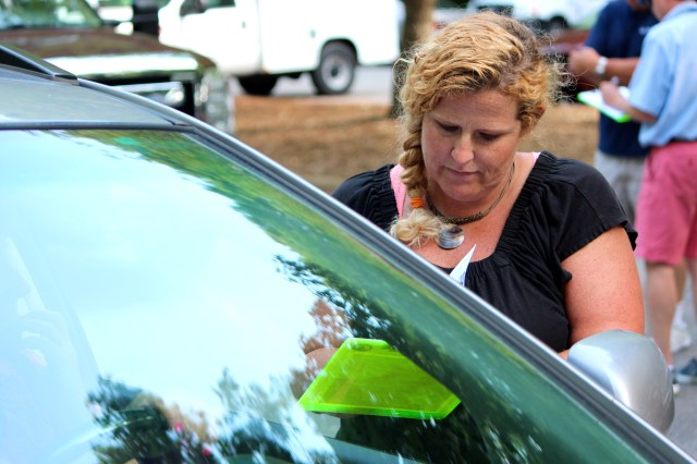 Revenue investigator Maggie Blynn helps a customer during a drive through personal property tax appeal. [John-Henry Doucette/The Princess Anne Independent News]