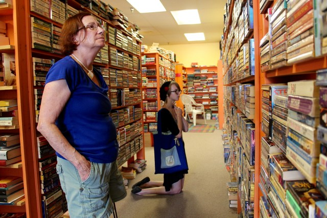 Donna Dehn, who lives near Lynnhaven Mall, and Jackie Tucker of Ocean Lakes examine the shelves at the Barritt's Books location at Strawbridge Marketplace, which will close on Aug. 31 following a sale. The local, family-run chain's other locations are staying put. [John-Henry Doucette/The Princess Anne Independent News]