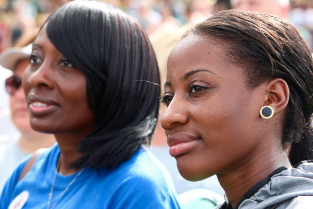 Rachel Williams-Dawkins and Shanell Dawkins of Newport News listen to speakers before the walk began. Williams-Dawkins has supported the walk four times, and this year was her daughter's first. [John-Henry Doucette/The Princess Anne Independent News]