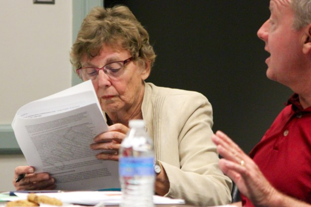 David Trimmer, the city's agriculture director, speaks to members of the Agricultural Advisory Commission, while City Councilmember Barbara Henley, reviews a draft chapter on the city's rural reaches this past month at the government center. [John-Henry Doucette/The Princess Anne Independent News]