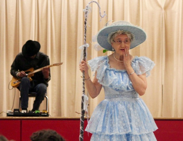 Mark Pettiford provides music during a performance of Mother Goose Live at Red Mill Elementary School. Paige Allen, as Little Bo Peep, looks for her missing sheep. [John-Henry Doucette/The Princess Anne Independent News]