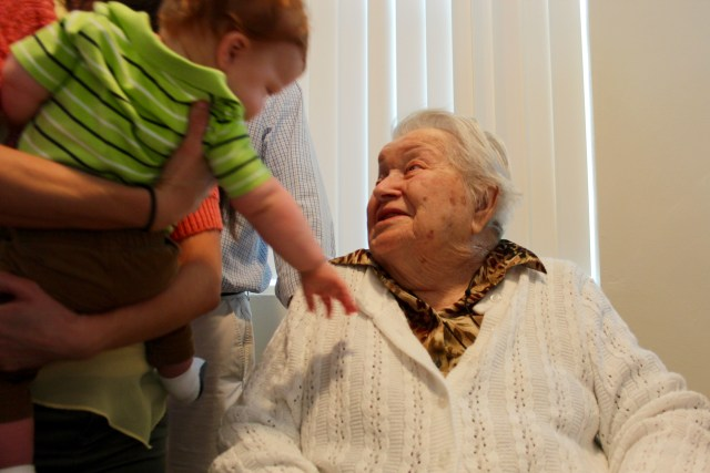 Melva Riggs, the longtime church pianist at Tabernacle United Methodist Church, is greeted by Ronnie Dixon, one of her great-great-great grandchildren, during a special party held this past month at the church in celebration of her 100th birthday. [John-Henry Doucette/The Princess Anne Independent News]