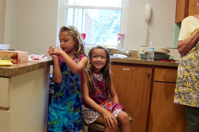 Sisters Hattie Peters, 6, and Henley Peters, 9, of Red Mill enjoyed cake in the kitchen during a break. [John-Henry Doucette/The Princess Anne Independent News]