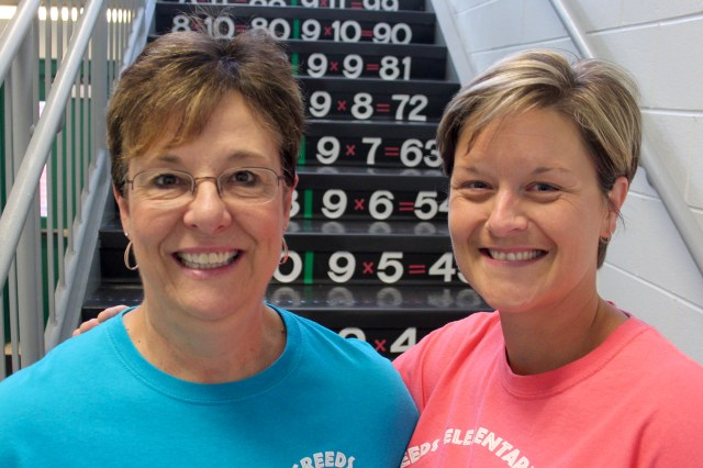 Creeds Elementary School office manager Debbie Brooks and principal Casey Conger created multiplication tables on stairs at the rural school over the summer. It's a new learning opportunity for returning students. [John-Henry Doucette/The Princess Anne Independent News]