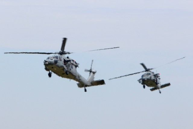 The Naval Air Station Oceana Air Show brought thousands of people to the base in Virginia Beach — including local fifth graders — to watch aircraft at work from Sept. 9-11, such as these two SH-60 Seahawks above. The helicopters appear distorted because they are seen photographed through jet wash from Blue Angels' F/A-18 Hornets, unseen in the frame, that are on the flight line in the foreground during the practice air show on Friday, Sept. 9. [John-Henry Doucette/The Princess Anne Independent News]