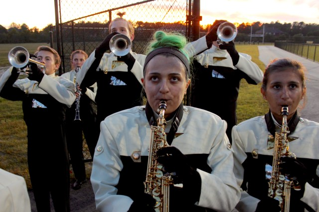 Ashlyn Campbell, 15, of Southgate and members of the band warm up before playing the National Anthem at the start of the Kellam-Salem game. [John-Henry Doucette/The Princess Anne Independent News]