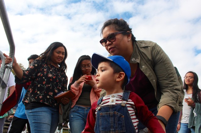 "Alexavier Acevedo, 3, looks at the livestock with his aunt, Kristine Hermoso of Larkspur. They had a good plan in place for the fair. ""We're going to get ice cream and look at the animals,"" Hermoso said. [John-Henry Doucette/The Princess Anne Independent News]"