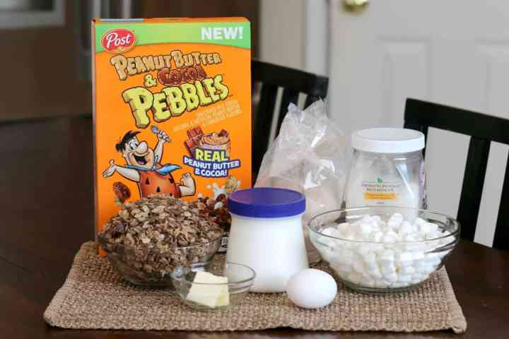 Ingredients needed for Ooey Gooey Peanut Butter and Chocolate Brownie Bars - Peanut Butter and Cocoa Pebbles, Marshmallow spread, mini marshmallows, butter, egg, brownie mix