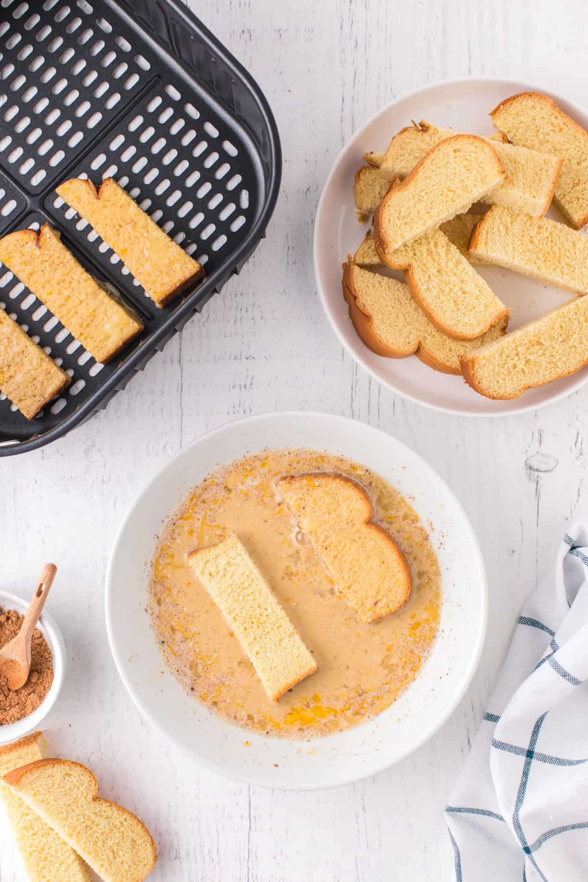 Dip Air Fryer French Toast Sticks in egg mixture