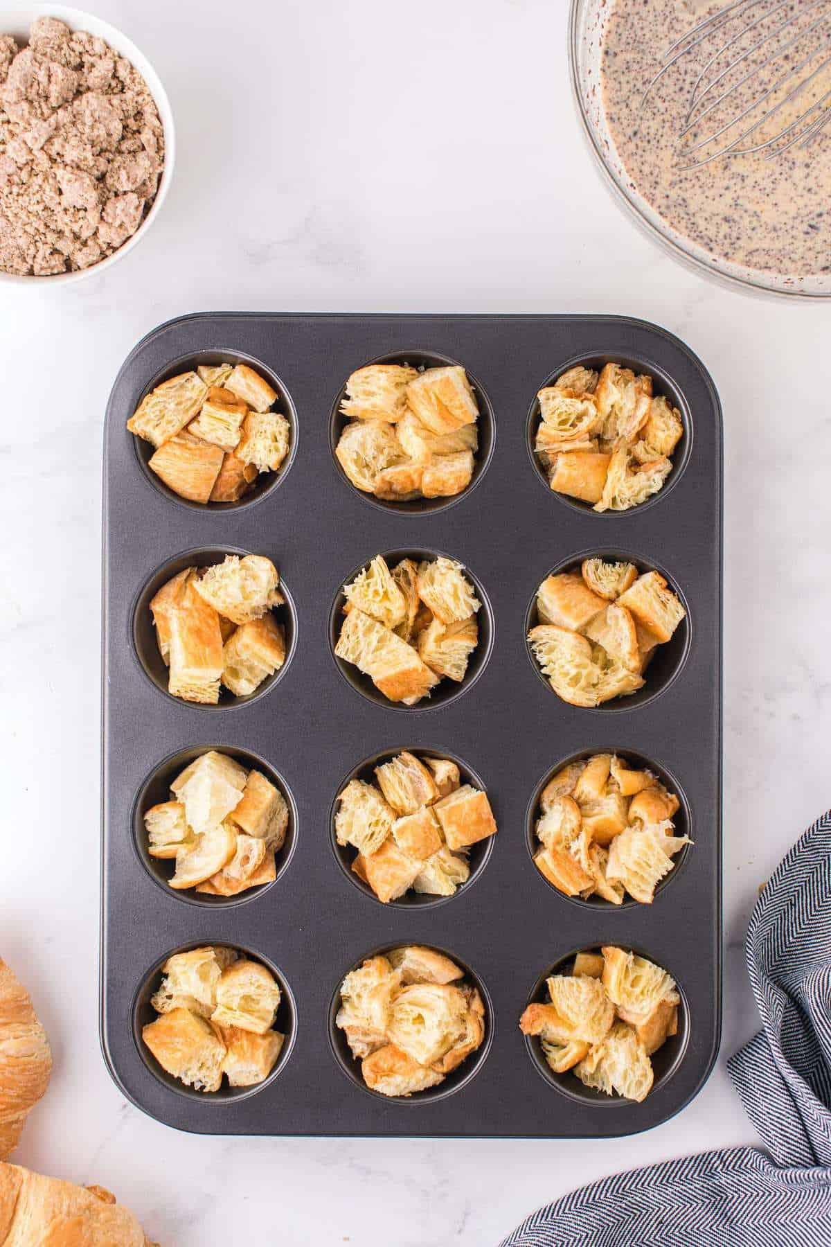 small croissant cubes in muffin tins