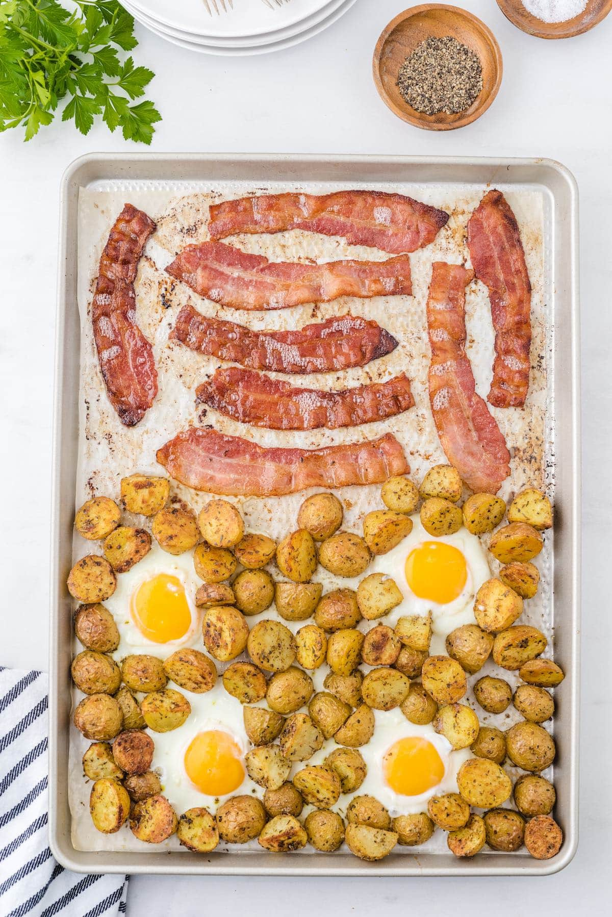 Bacon, potatoes and eggs in the baking dish