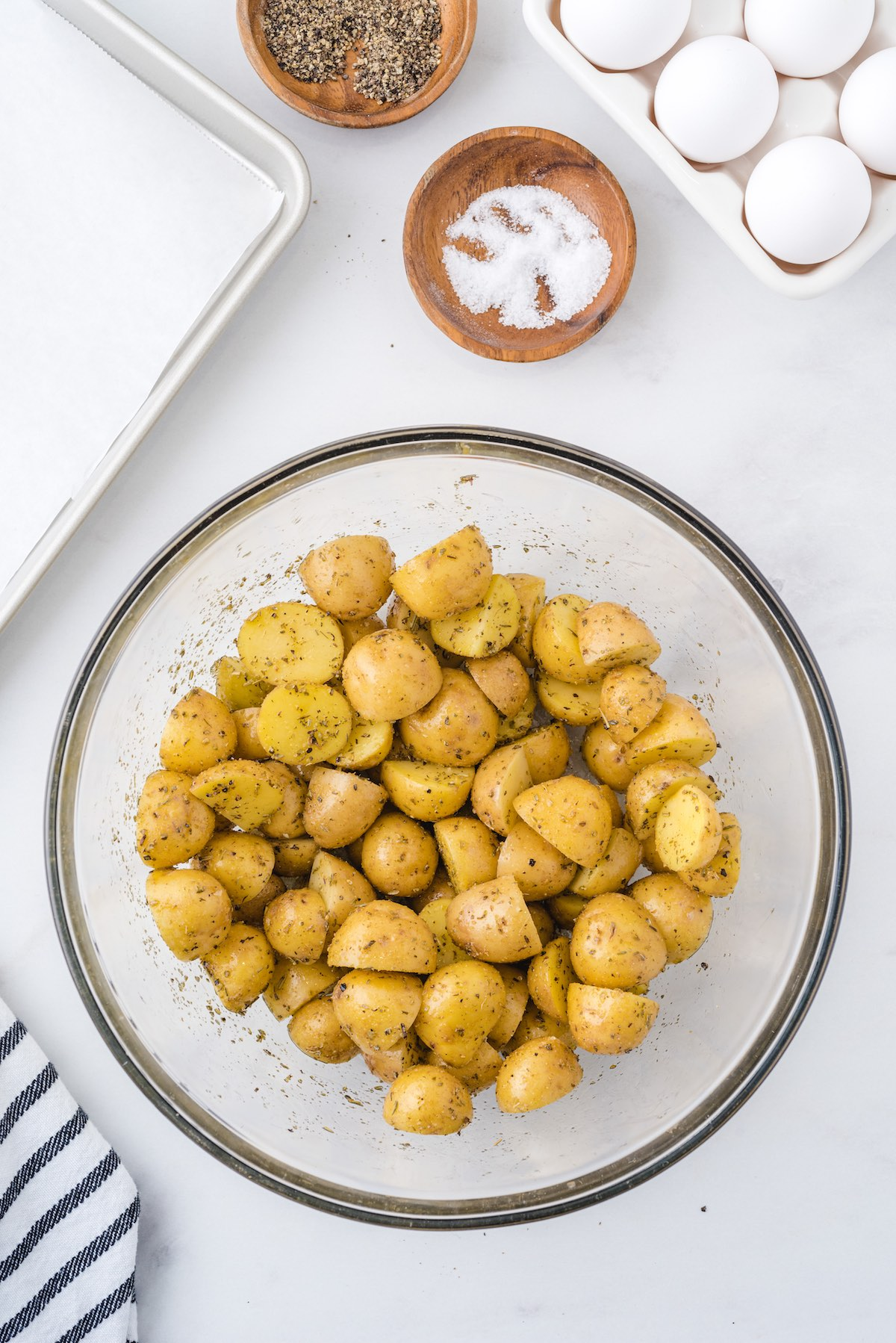 Potatoes with spices in bowl