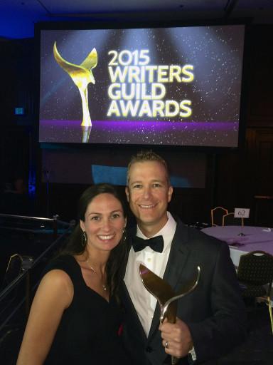 Bob poses with WGA award and wife