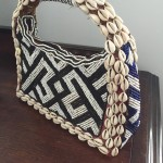 3 cowry shell and bead purse