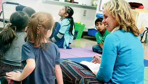 Woodson Kindergarten Center Principal Jessica Cabeen talks with Carly McMahan in the Red Moose room Thursday. Cabeen is interacting with all of Woodson's roughly 300 students and sending positive, personalized notes home to parents. Jason Schoonover/jason.schoonover@austindailyherald.com