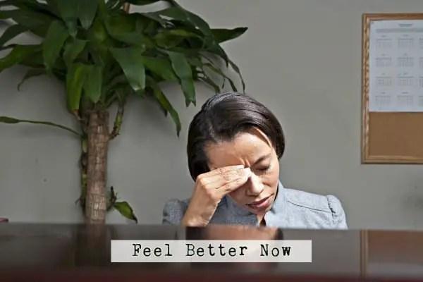 business-woman-with-headache_htilogass