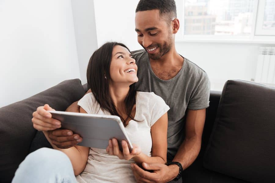 Couple Using Udemy Coupon Codes