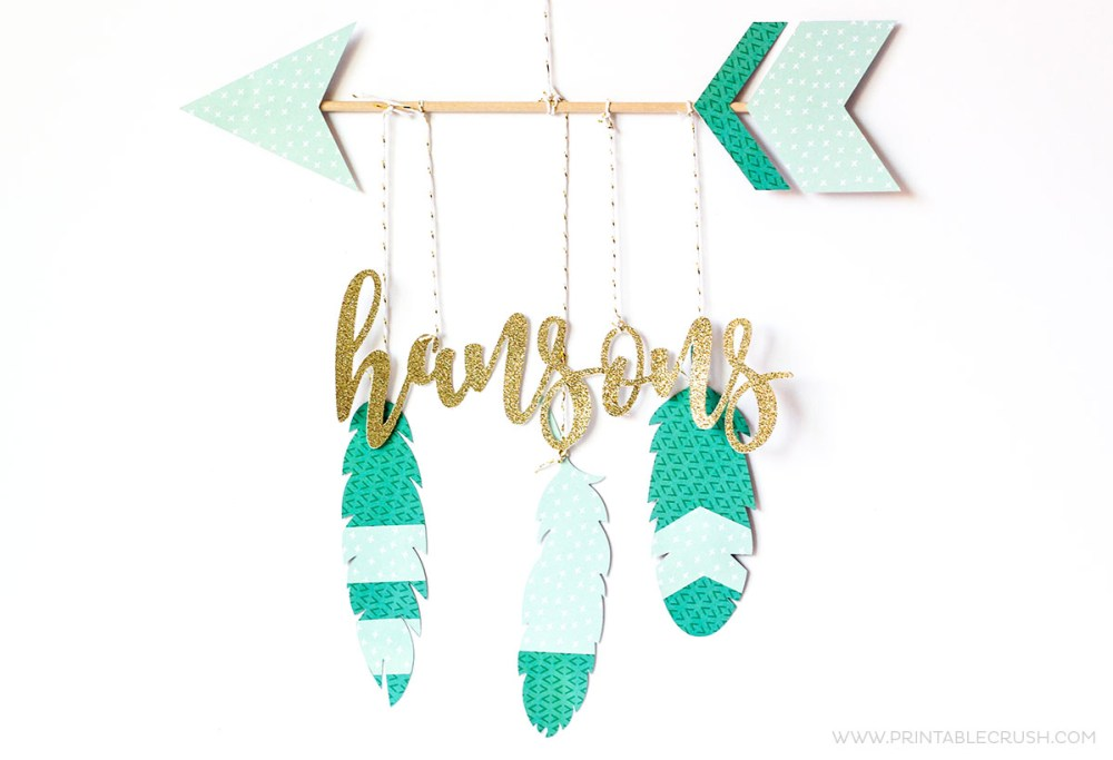 Teal and white paper feathers hanging mobile