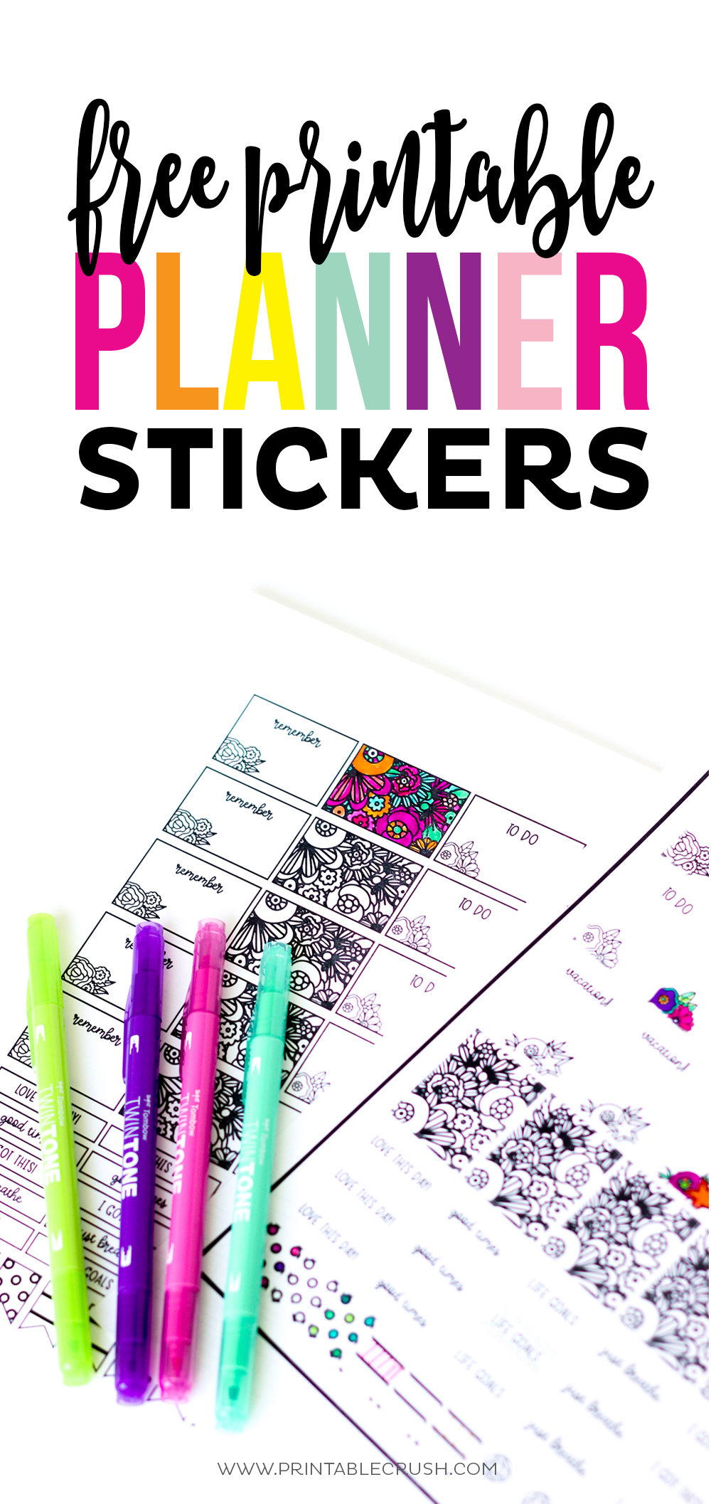 Sheets of black and white printable planner stickers with colored pens laying on them.