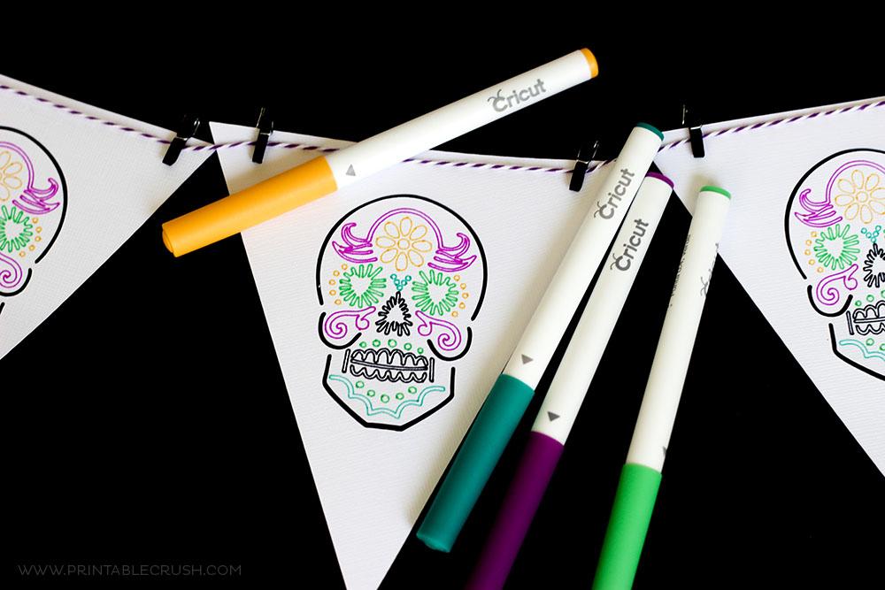 Use different Cricut Pen Colors to create this gorgeous Dia De Los Muertos banner!