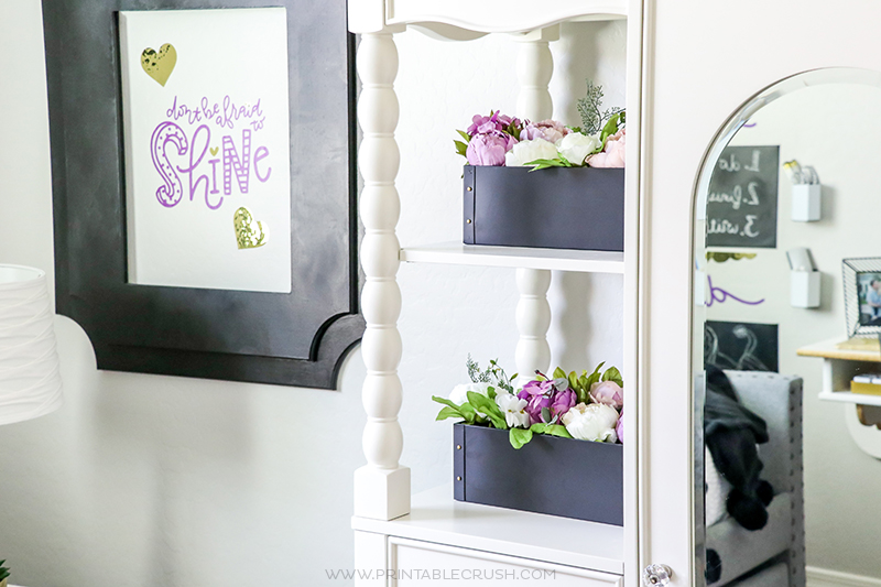 Keep tween bedroom shelves clutter free with simple decorations like these metal planters filled with fake peonies.