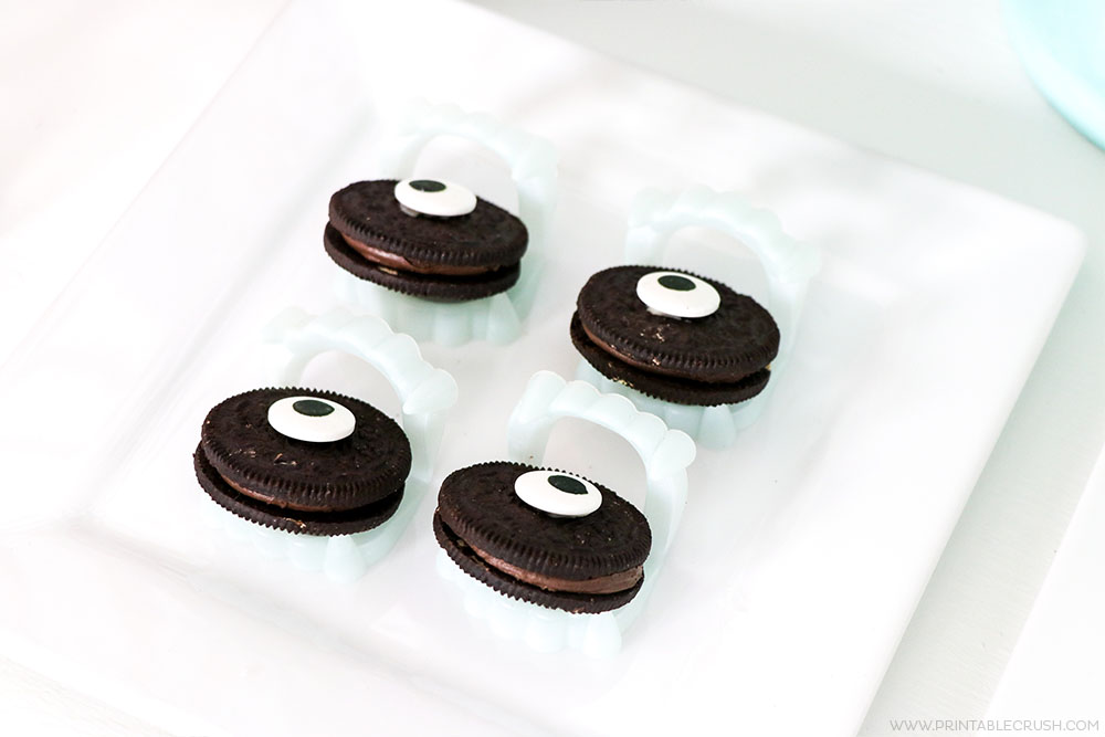Simply place some eyeballs on oreos to create a fun and easy Halloween party treat!