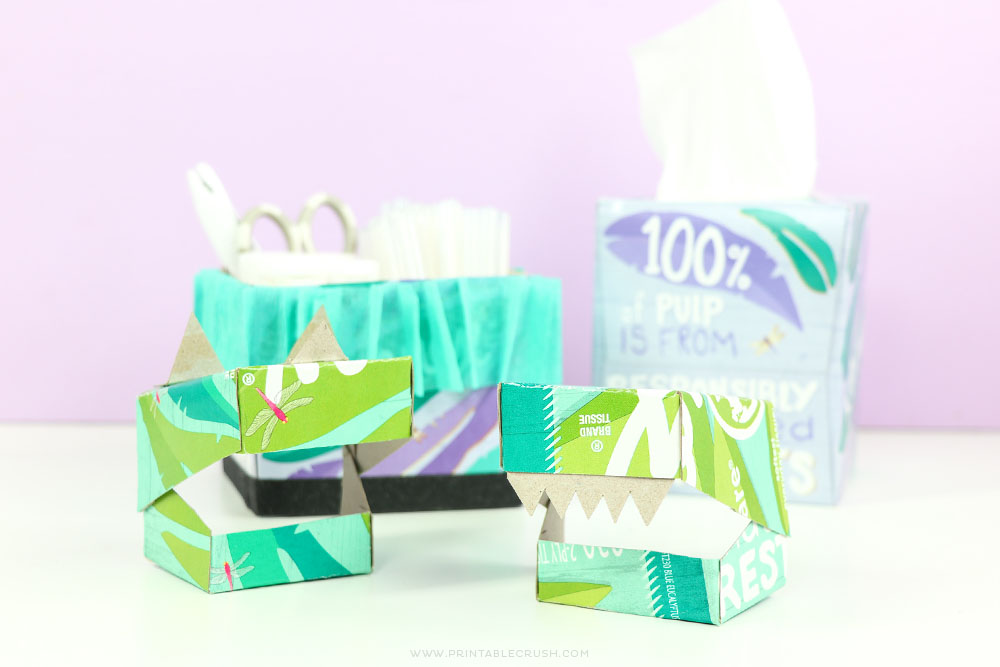 You can create so many fun recycled crafts this Earth Month - including these cute Dinosaur masks and craft supply storage box!