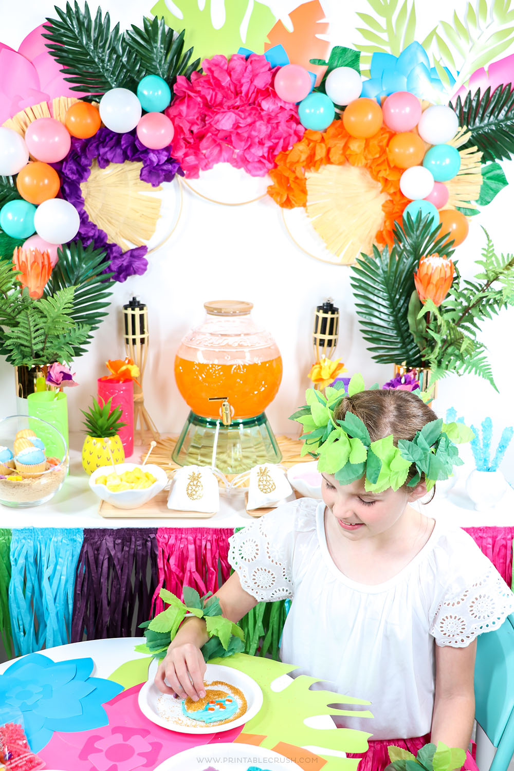Add a creative space to your luau party with this cute and easy Luau Cookie Decorating Station