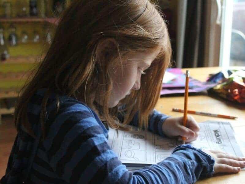 girl-doing-homework-ehlp-child-succeed