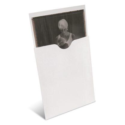 Sleeved negative shown inside envelope