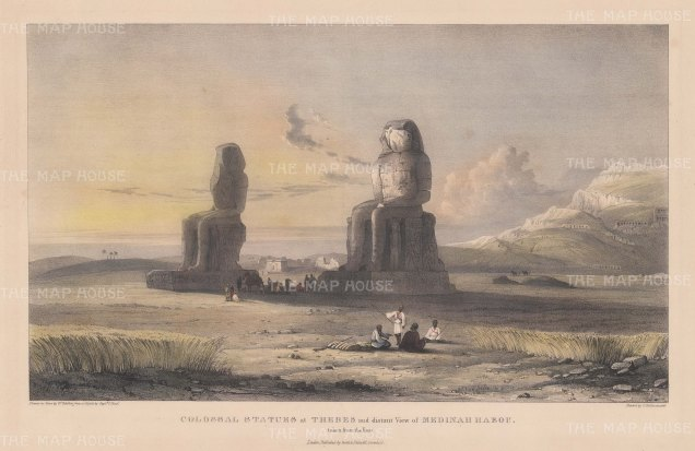 Colossi of Memnon and a distant view of Medinat Habu.