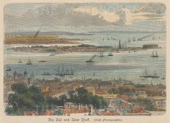 New York City: Looking over Ellis Island, the Statue of Liberty and New York harbour.