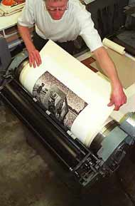 Artists' Press founder Mark Attwood at work on the letterpress
