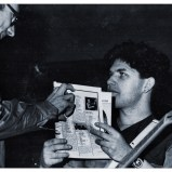 "3-3-83 Chief editor of the Belgian magazine Telemoustique shows Charlie the results of the ""pop poll"" which Simple Minds won in 1983"