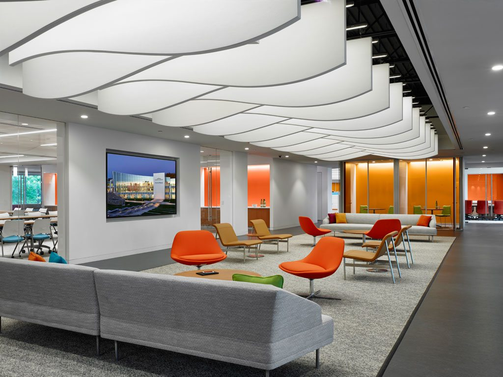 Pictured above is an entryway gathering space just off the main lobby. A variety of CertainTeed's acoustical ceiling products are featured throughout. This area features SilentFX® for the walls and ceilings and an exposed structure with Decoustics® Baffles. Photo: © Jeffrey Totaro