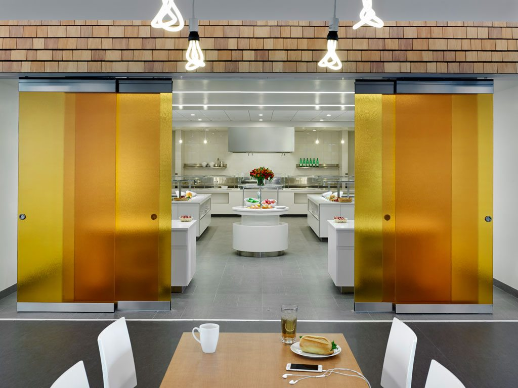 In the cafeteria, CertainTeed's Cedar Impressions® Individual Sawmill polymer shingles proved to be an interesting indoor commercial application of a traditional outdoor residential product. In addition, the cafeteria's kitchen uses CertainTeed Diamondback® GlasRoc® Tile Backer for moisture and mold resistance. Photo: © Jeffrey Totaro
