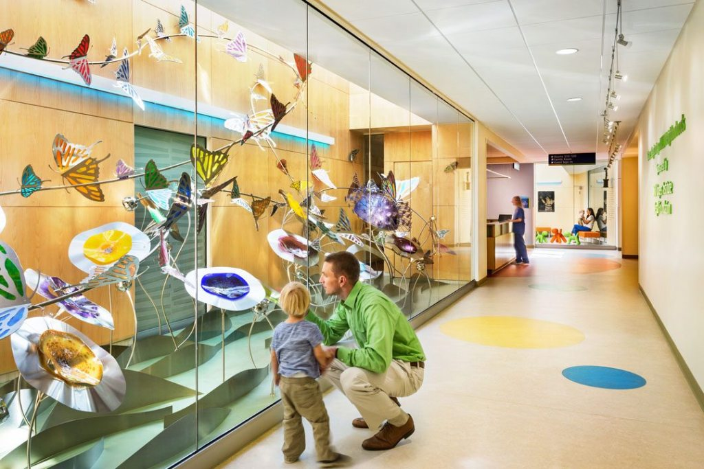 At East Tennessee Children's Hospital in Knoxville, light courts were incorporated into the design and planning of the unit, providing daylight to every interior room. They define the neighborhood organizational model for the unit, making the space feel more personal and private and contributing to intuitive wayfinding. BarberMcMurry served as the architect-of-record and Shepley Bulfinch was design architect. Photo: © 2017 Denise Retallack