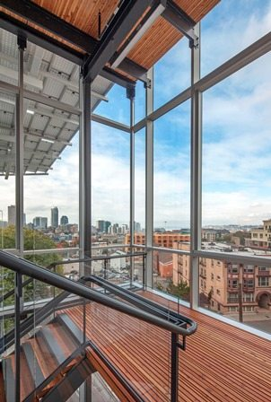 """The signature design element of the six-story Bullitt Center in Seattle is the """"irresistible stairway,"""" featuring Starphire glass by Vitro Glass, providing panoramic views of Seattle and Puget Sound. Photos © 2014 Tom Kessler. All Rights Reserved."""